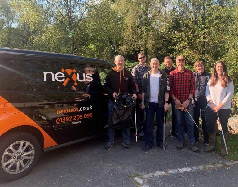 Nexus staff pose next to the Nexus van